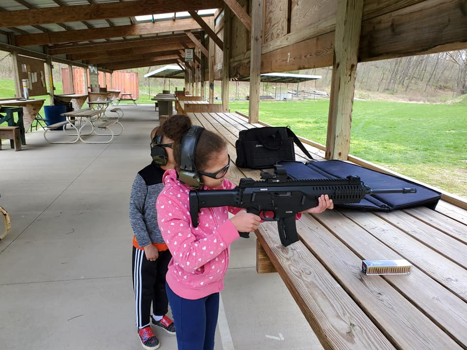 Children learning to shoot firearms safely and legally